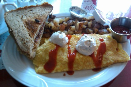 Mexican Omelet W/ red river toast and home fries.